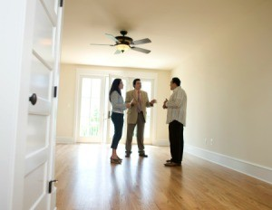 Couple speaking with property manger about renting a house