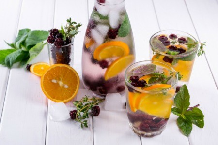Herbs and fruits in chilled water care and glasses