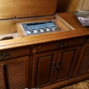 Value of a Vintage Stereo and Radio Console - stereo and radio in medium wood console cabinet