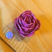 Egg Carton Rose Brooch - brooch on the front of a yellow cardigan
