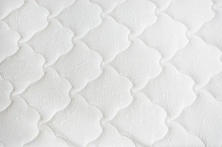 Close up of a mattress.