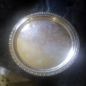 Determining the Value of a Heavy Silver Platter - round silver platter with decorated edge