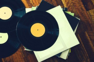 Stack of records on a wooden floor