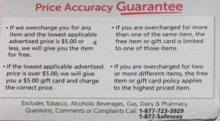 A Price Accuracy Guarantee sign at a grocery store.