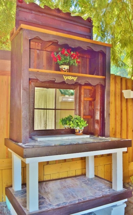 A small potting bench in a backyard.