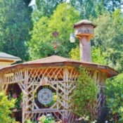 A wooden gazebo in a backyard