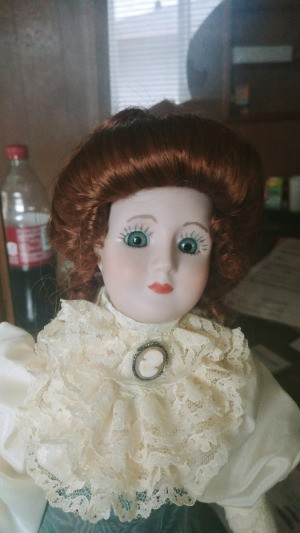 Identifying a Porcelain Doll - period doll with lace ruffle and cameo