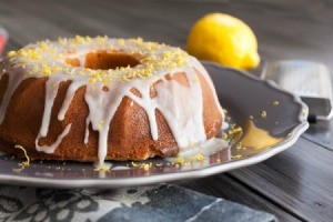 Bundt cake glazed and topped with lemon zest.