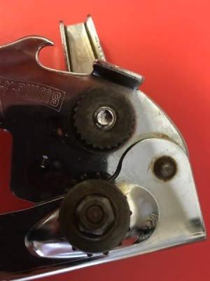 A can opener that has had rust cleaned from the cutting blades.
