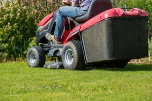 Mowing the lawn with tractor mower.