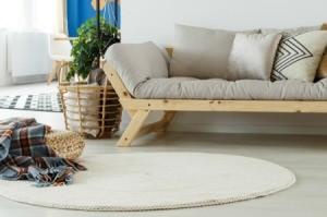 Round white rug in livingroom.