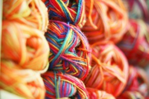 Stacks of colorful knitting yarn