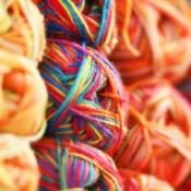 Stacks of colorful knitting yarn