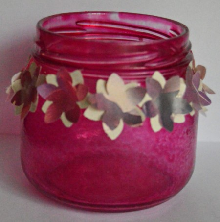 Floral Glass Jar Wedding Favor - glue the cream flowers around the jar leaving petals free to bend then glue the wrapping paper flowers on top again leaving them loose at petals
