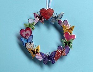 Making a Mini Wreath with Stickers - finish with two larger stickers one at the top and one at the bottom