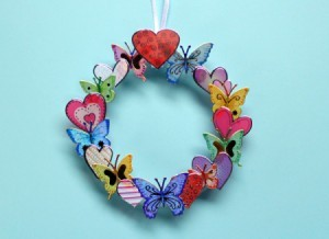 Making a Mini Wreath with Stickers - wreath hanging against a blue background