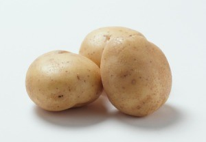 The potatoes on a white background