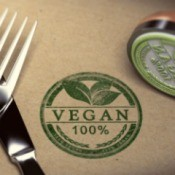 100% Vegan stamp next to knife and fork