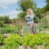 Woman standing in her vegetable garden