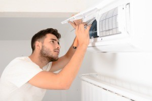 Man doing maintenance on his air conditioner