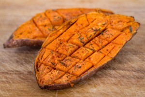 Baked sweet potato cut into cubes with in the skin.