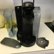 A preowned Keurig coffee maker in a kitchen.