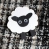 Cardstock Sheep Badge - brooch on black and white garment