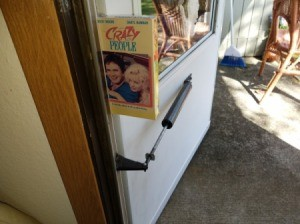 A VHS tape being used to prop a door open.