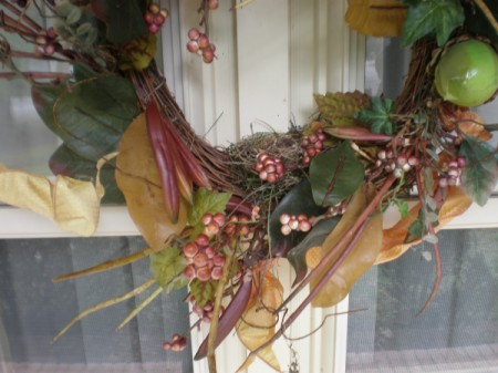 A bird's nest built inside a decorative wreath.