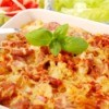 Casserole with potato, sausage and onion.