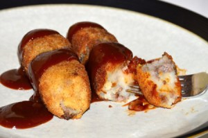 Japanese Croquettes on plate with sauce