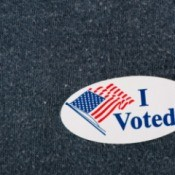 """I Voted"" sticker on a navy sweater."