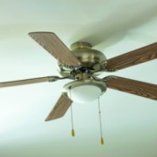 Ceiling fan with faux wood blades.