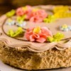 Kiev cake with light brown cream on wooden table