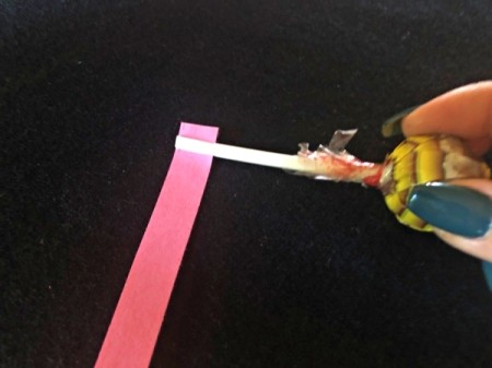 DIY Lollipop Paper Quilling Tool - after stick cools insert paper strip and pull up even with the end of the stick