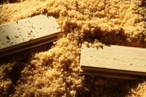 Two boards surrounded by sawdust.