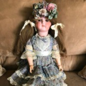 Identifying a Porcelain Doll - doll in print dress with lace