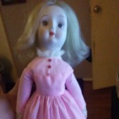 Identifying a Porcelain Doll - doll in a pink dress