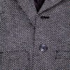 A wool overcoat in a houndstooth pattern.