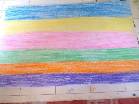 Crayon Etching - color different stripes on a piece of paper