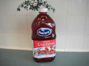 A full cranberry juice container.