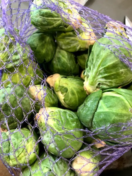 Brussels sprouts in a mesh bag.