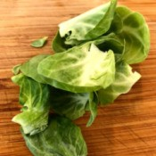 Stray leaves from Brussels sprouts that have been cut in half.