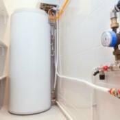 Water heater tank in a closet.