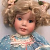 Identifying a Porcelain Doll -  blond doll with a blue dress