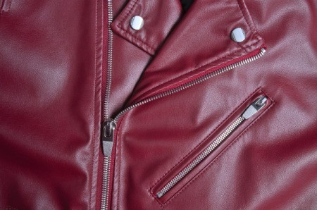 Close up of a maroon red leather jacket.