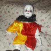 Identifying Porcelain Dolls - clown doll with yellow and red outfit