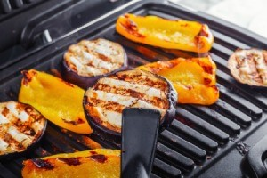 Eggplant and yellow peppers on a electric grill.