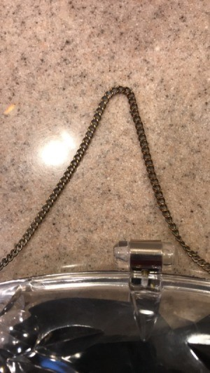 A tarnished chain that has been cleaned on the left hand side.