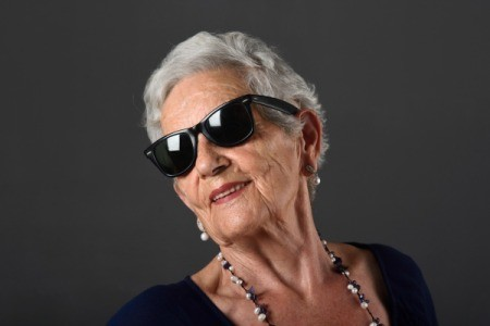 Woman with grey hair wearing sunglasses